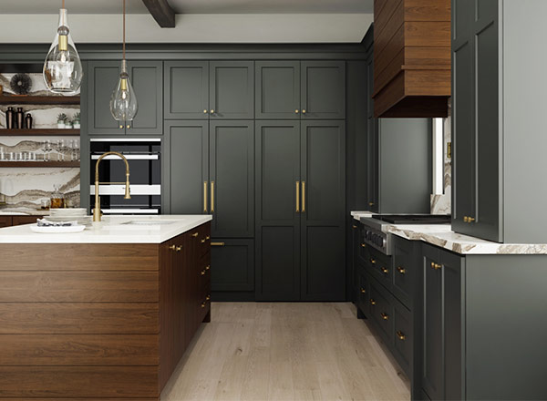 A kitchen with charcoal grey cabinets and gold handles
