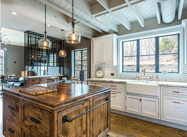 A kitchen with a wooden countertop island