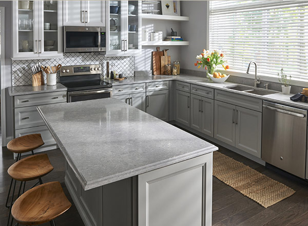 A kitchen with a grey countertop